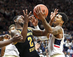 Wichita State's Jamarius Burton (2) and Connecticut's Jalen Adams (4) vie for a rebound during the first half of an NCAA college basketball game Saturday, Jan. 26, 2019 in Storrs, Conn. (AP Photo/Stephen Dunn)