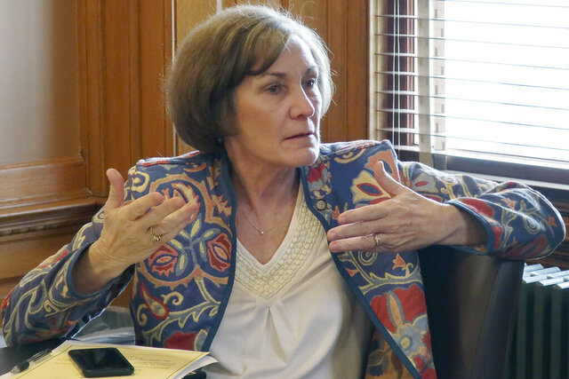 "FILE - In this Feb. 13, 2019, file photo, state Sen. Barbara Bollier, D-Mission Hills, speaks during a meeting of Democratic senators at the Statehouse in Topeka, Kan. Bollier is pitching herself as a ""voice of reason"" with a decade's worth of working with lawmakers from both parties (AP Photo/John Hanna File)"