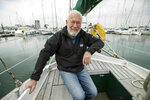 In this Friday, April 12, 2019 photo, Sir Robin Knox-Johnston poses the deck of his boat Suhaili in Gosport, England. Monday, April 22, 2019, commemorates the 50th anniversary of the finish, when Knox-Johnston achieved the nautical equivalent of climbing Mount Everest when he became the first man to sail alone around the world nonstop. (Andrew Matthew/PA via AP)