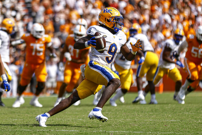 Pittsburgh defensive back Brandon Hill (9) returns an interception during the second half of an NCAA college football game against Tennessee, Saturday, Sept. 11, 2021, in Knoxville, Tenn. (AP Photo/Wade Payne)