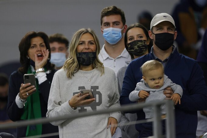 Fans watch warmups before the Rose Bowl NCAA college football game between Notre Dame and Alabama in Arlington, Texas, Friday, Jan. 1, 2021. (AP Photo/Ron Jenkins)
