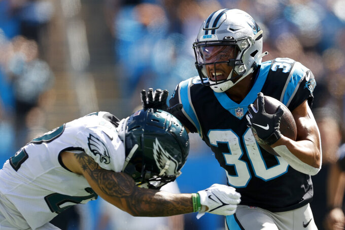 Carolina Panthers running back Chuba Hubbard is tackled by Philadelphia Eagles safety Marcus Epps during the first half of an NFL football game Sunday, Oct. 10, 2021, in Charlotte, N.C. (AP Photo/Nell Redmond)