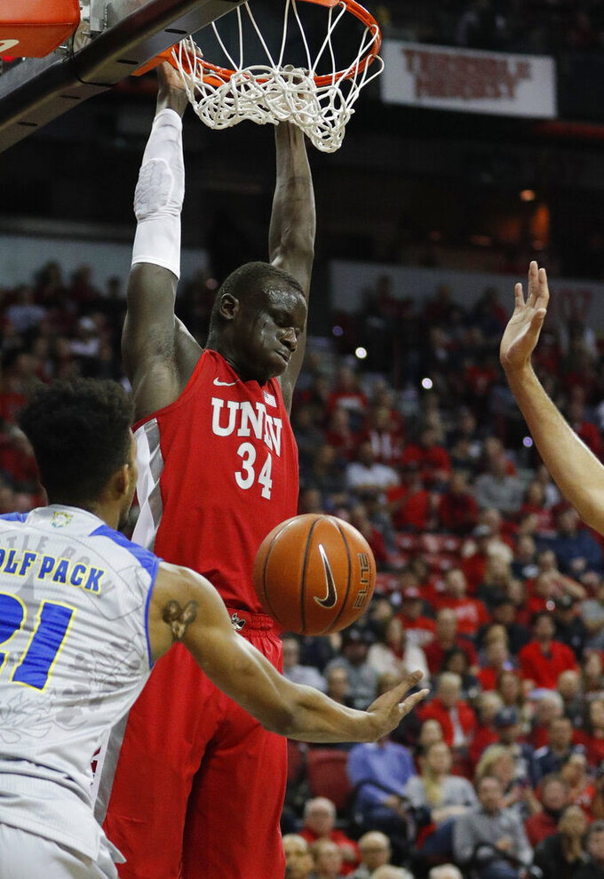 UNLV's Cheikh Mbacke Diong dunks against Nevada during the first half of an NCAA college basketball game Tuesday, Jan. 29, 2019, in Las Vegas. (AP Photo/John Locher)