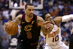 Cleveland Cavaliers guard George Hill (3) drives on Phoenix Suns guard Shaquille Harrison in the first half during an NBA basketball game, Tuesday, March 13, 2018, in Phoenix. (AP Photo/Rick Scuteri)