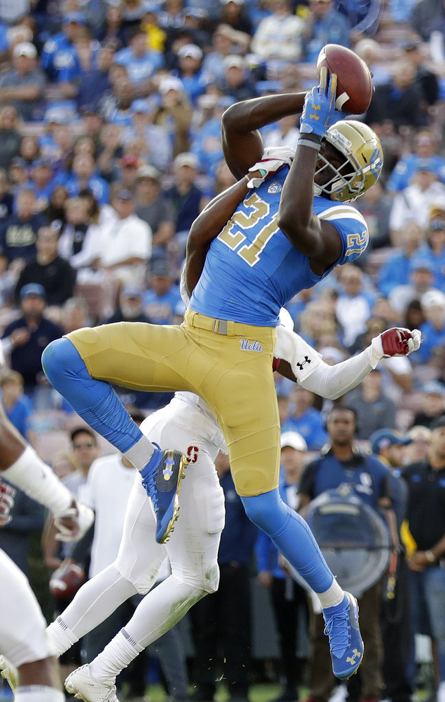 UCLA wide receiver Michael Ezeike (21) makes a catch against Stanford during the second half of an NCAA college football game Saturday, Nov. 24, 2018, in Pasadena, Calif. (AP Photo/Marcio Jose Sanchez)