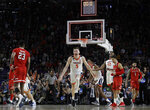 FILE - In this April 8, 2019, file photo, Virginia's Kyle Guy (5) and his teammates celebrate after defeating Texas Tech 85-77 in overtime in the championship of the Final Four NCAA college basketball tournament in Minneapolis. (AP Photo/David J. Phillip, File)