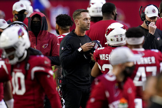 Arizona Cardinals head coach Kliff Kingsbury watches during the second half of an NFL football game against the Buffalo Bills, Sunday, Nov. 15, 2020, in Glendale, Ariz. (AP Photo/Ross D. Franklin)