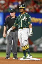 Oakland Athletics' Khris Davis smiles while standing on second base after hitting a two-run double during the fifth inning of the team's baseball game against the St. Louis Cardinals on Tuesday, June 25, 2019, in St. Louis. (AP Photo/Scott Kane)