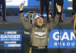 Sheldon Creed celebrates in Victory Lane after winning the NASCAR Truck Series auto race at Phoenix Raceway, Friday, Nov. 6, 2020, in Avondale, Ariz. With the victory, Creed captured the season championship. (AP Photo/Ralph Freso)