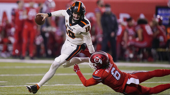 Oregon State quarterback Chance Nolan (10) breaks the tackle of Utah safety Nate Ritchie (6) during the first half of an NCAA college football game Saturday, Dec. 5, 2020, in Salt Lake City. (AP Photo/Rick Bowmer)