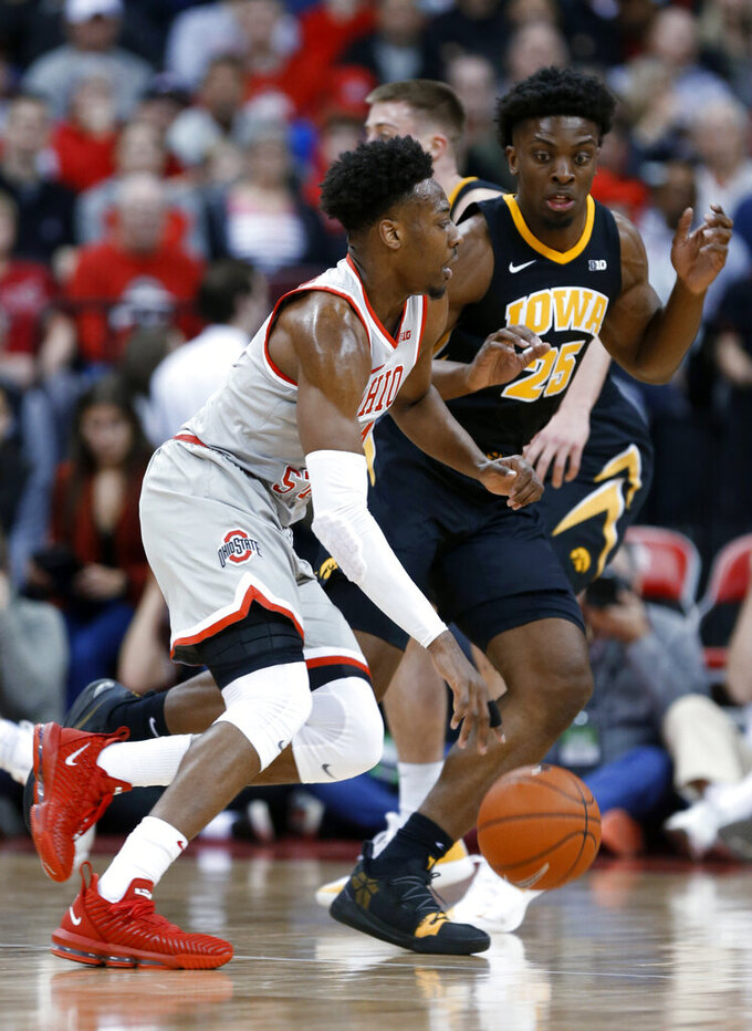 Ohio State forward Andre Wesson, left, drives against Iowa forward Tyler Cook during the first half of an NCAA college basketball game in Columbus, Ohio, Tuesday, Feb. 26, 2019. (AP Photo/Paul Vernon)