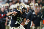 Colorado quarterback Steven Montez runs for a first down against Colorado State during the third quarter of an NCAA college football game Friday, Aug. 30, 2019, in Denver. (AP Photo/David Zalubowski)