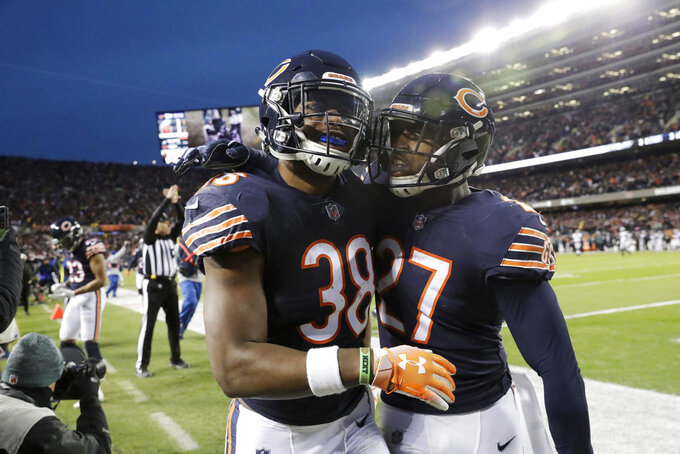 Chicago Bears strong safety Adrian Amos (38) celebrates with defensive back Sherrick McManis (27) after Amos intercepted a pass during the first half of an NFL wild-card playoff football game against the Philadelphia Eagles Sunday, Jan. 6, 2019, in Chicago. (AP Photo/Nam Y. Huh)