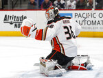Anaheim Ducks goaltender John Gibson makes a glove save of a shot by the Colorado Avalanche during the first period of an NHL hockey game Friday, March 15, 2019, in Denver. (AP Photo/David Zalubowski)