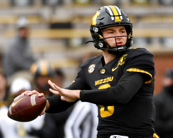 FILE - In this Dec. 12, 2020, file photo, Missouri quarterback Connor Bazelak throws during the first half of an NCAA college football game against Georgia in Columbia, Mo. Bazelak is back under center after wresting control of the quarterback job from Shawn Robinson about five quarters into last season. (AP Photo/L.G. Patterson, File)