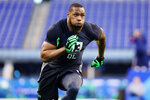 FILE - In this Feb. 28, 2016, file photo, Baylor defensive lineman Shawn Oakman performs a drill at the NFL football scouting combine in Indianapolis. Former Baylor University President Ken Starr told the Waco Tribune-Herald that he hosted a fundraiser at his home for the legal defense fund of Shawn Oakman, a former star defensive end for the Bears who was acquitted of rape last month. Starr was fired as Baylor's president in 2016, after an investigation determined there was a