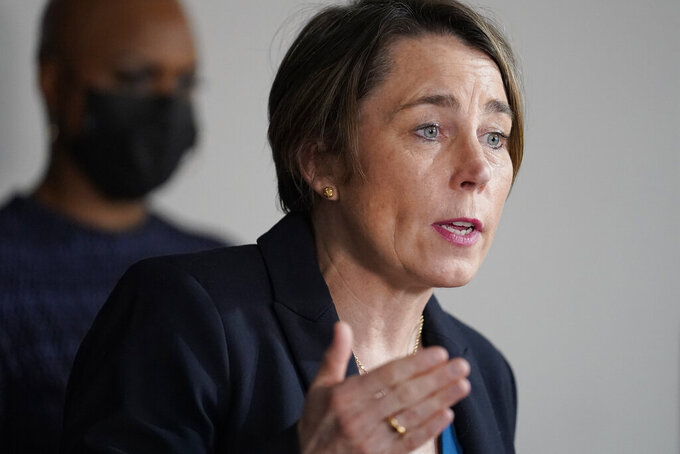 FILE - In this April 1, 2021 file photo, Mass. Attorney General Maura Healey, right, responds to questions from reporters as U.S. Rep. Ayanna Pressley, D-Mass., left, looks on during a news conference in Boston. Healey says Purdue Pharma's plan to settle thousands of lawsuits over the U.S. opioid epidemic doesn't go far enough to hold members of the Sackler family accountable for the crisis. It would preserve the vast majority of the wealth held by the family members who own the company that makes OxyContin.  (AP Photo/Steven Senne)