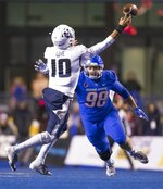 Boise State nose tackle Sonatane Lui (98) puts pressure on Utah State quarterback Jordan Love (10) during the second quarter of an NCAA college football game Saturday, Nov. 24, 2018, in Boise, Idaho. (Darin Oswald/Idaho Statesman via AP)