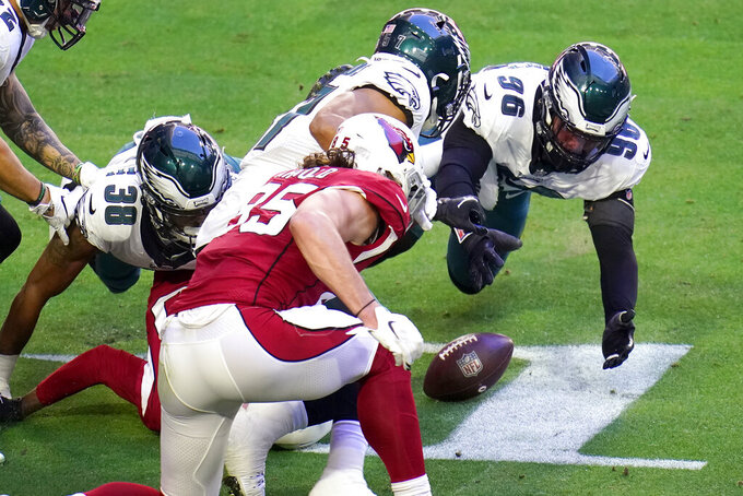 Philadelphia Eagles defensive end Derek Barnett (96) dives for a fumble by Arizona Cardinals wide receiver DeAndre Hopkins during the first half of an NFL football game, Sunday, Dec. 20, 2020, in Glendale, Ariz. The Eagles recovered the ball. (AP Photo/Ross D. Franklin)