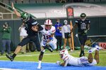 Tulane quarterback Michael Pratt (7) scores a touchdown against SMU safety Chace Cromartie (18) in the second half during an NCAA college football game in New Orleans, Friday, Oct. 16, 2020. (AP Photo/Matthew Hinton)