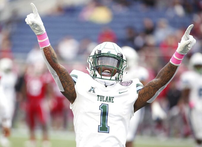 Tulane cornerback Donnie Lewis Jr. cheers after a play during the Cure Bowl NCAA college football game against Louisiana in Orlando, Fla, on Saturday, Dec. 15, 2018. (Stephen M. Dowell/Orlando Sentinel via AP)