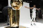 Milwaukee Bucks' Giannis Antetokounmpo poses for a picture during an NBA basketball media day Monday, Sept. 27, 2021, in Milwaukee. (AP Photo/Morry Gash)