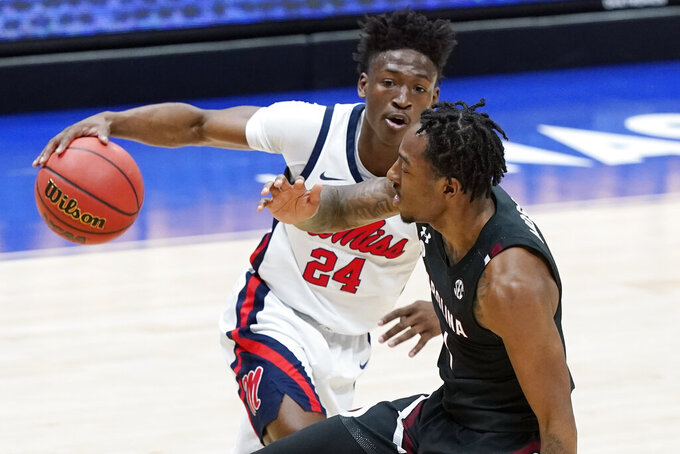 Mississippi's Jarkel Joiner (24) drives against South Carolina's T.J. Moss, right, in the first half of an NCAA college basketball game in the Southeastern Conference Tournament Thursday, March 11, 2021, in Nashville, Tenn. (AP Photo/Mark Humphrey)