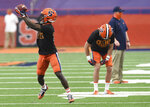 Syracuse wide receiver Nykeim Johnson, left, works out before an NCAA college football game against Boston College, Saturday, Nov. 7, 2020, at the Carrier Dome in Syracuse, N.Y. (Dennis Nett/The Post-Standard via AP)