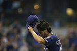 Milwaukee Brewers' Gio Gonzalez tips his cap after being removed during the seventh inning of a baseball game against the Pittsburgh Pirates, Sunday, Sept. 22, 2019, in Milwaukee. (AP Photo/Aaron Gash)