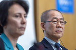 Elena Manaenkova, left, WMO Deputy Secretary-General and Hoesung Lee, right, chair of the United Nations Intergovernmental Panel on Climate Change (IPCC) attend a news conference on the Special Report on Climate Change and Land after IPCC's 50th session in Geneva, Switzerland, Thursday, Aug. 8, 2019. (Martial Trezzini/Keystone via AP)