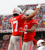 Ohio State receiver Chris Olave, left, celebrates his touchdown against Penn State with teammate Binjimen Victor during the second half of an NCAA college football game Saturday, Nov. 23, 2019, in Columbus, Ohio. Ohio State beat Penn State 28-17. (AP Photo/Jay LaPrete)