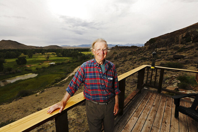Bill Childrey, 75, poses at his home near the Big Hole River by Glen, Montana on July 28, 2020. Childrey was fishing along the river last weekend when he was bitten by a rattlesnake. (Meagan Thompson/The Montana Standard via AP)