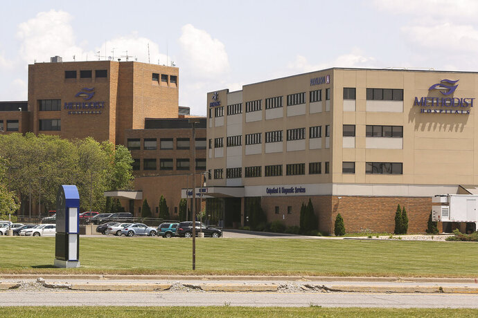 This June 9, 2017 photo shows Methodist Hospital in Merrillville, Ind. Methodist hospital system in northwestern Indiana is informing more than 68,000 patients that their personal information may have been exposed during a data breach earlier this year. The Northwest Indiana Times reported Wednesday that Methodist Hospitals has been mailing letters to patients detailing the steps they can take to safeguard themselves against possible fraud. The hospital system says it has no proof that information from the patients was accessed, but it could not rule out the prospect. (John J. Watkins/The Times via AP)