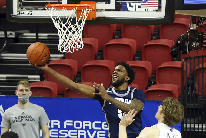 Nevada forward Warren Washington (5) shoots as Boise State center Lukas Milner defends during the second half of an NCAA college basketball game in the quarterfinals of the Mountain West Conference men's tournament Thursday, March 11, 2021, in Las Vegas. (AP Photo/Isaac Brekken)
