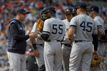 New York Yankees starting pitcher Domingo German (55) is pulled from the game by manager Aaron Boone, left, during the seventh inning of the team's baseball game against the Baltimore Orioles, Sunday, April 7, 2019, in Baltimore. (AP Photo/Will Newton)