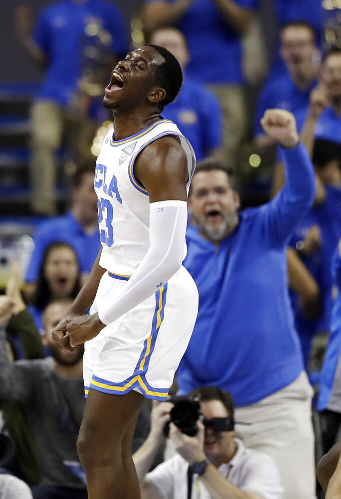 UCLA's Prince Ali reacts after scoring on a dunk against California during the first half of an NCAA college basketball game Saturday, Jan. 5, 2019, in Los Angeles. (AP Photo/Marcio Jose Sanchez)