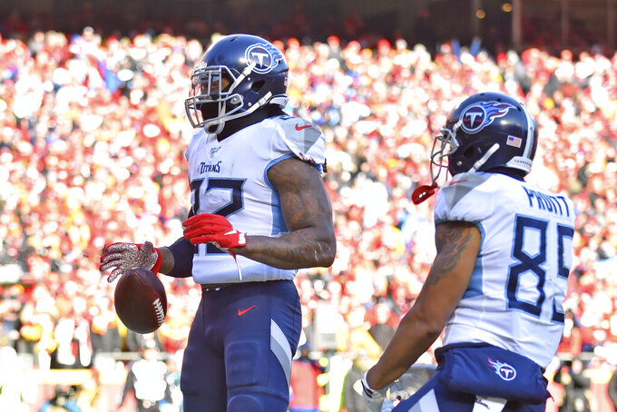 Tennessee Titans' Derrick Henry (22) reacts after running for a touchdown during the first half of the NFL AFC Championship football game against the Kansas City Chiefs Sunday, Jan. 19, 2020, in Kansas City, MO. (AP Photo/Ed Zurga)