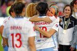 Chicago Red Stars' Nikki Stanton, center right, embraces teammate Yūki Nagasato (12) following the team's loss to the North Carolina Courage at an NWSL championship soccer game in Cary, N.C., Sunday, Oct. 27, 2019. (AP Photo/Karl B DeBlaker)