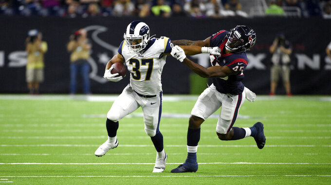 Los Angeles Rams running back Matt Colburn (37) is tackled by Houston Texans defensive back A.J. Hendy (45) during the second half of a preseason NFL football game Thursday, Aug. 29, 2019, in Houston. (AP Photo/Eric Christian Smith)