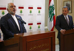 Iranian Foreign Minister Mohammad Javad Zarif, left, speaks during a press conference with his Lebanese counterpart Gebran Bassil, in Beirut, Lebanon, Monday, Feb. 11, 2019. Zarif extended an offer for Iranian military assistance to the U.S.-backed Lebanese army on Sunday, saying Iran is ready to assist in all sectors should the Lebanese government want it. (AP Photo/Hussein Malla)
