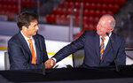 FILE - In this Monday, June 17, 2019, file photo, new Anaheim Ducks head coach Dallas Eakins, left, is introduced by general manager Bob Murray during an NHL hockey news conference in Irvine, Calif. For the teams that missed the 2020 playoffs, they've spent the past 10 months waiting for the compressed 56-game 2021 season. (Paul Bersebach/The Orange County Register via AP, File)