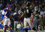 Chicago White Sox's Eloy Jimenez (74) celebrates at home plate after hitting a two-run home run while Chicago Cubs catcher Victor Caratini left, looks on during the ninth inning of a baseball game Tuesday, June 18, 2019, at Wrigley Field in Chicago. White Sox won 3-1. (AP Photo/Paul Beaty)