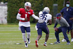 New England Patriots quarterback Cam Newton (1) hands off to running back Sony Michel (26) during an NFL football training camp practice, Thursday Aug. 27, 2020 in Foxborough, Mass. (AP Photo/Steven Senne, Pool)