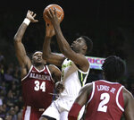 Baylor guard Mario Kegler (4) shoots over Alabama guards Tevin Mack, left, and Kira Lewis Jr., right, during the second half of an NCAA college basketball game, Saturday, Jan. 26, 2019, in Waco, Texas. (Rod Aydelotte/Waco Tribune-Herald via AP)