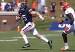 Virginia quarterback Brennan Armstrong (5) runs with the ball next to Illinois defensive back Derrick Smith (4) during an NCAA college football game, Saturday, Sept. 11, 2021, at Scott Stadium in Charlottesville, Va. (Andrew Shurtleff/The Daily Progress via AP)