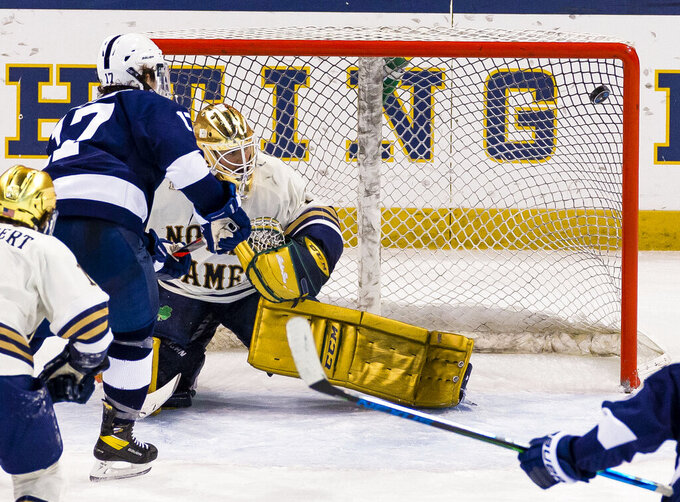 A shot gets past Notre Dame's Dylan St. Cyr (1) during an NCAA college hockey game against Penn State in a Big Ten Hockey Tournament game Sunday, March 14, 2021, in South Bend. (Michael Caterina/South Bend Tribune via AP)
