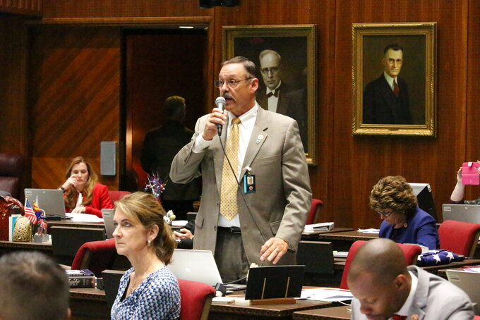 FILE - In this May 2, 2018, file photo, Republican Rep. Mark Finchem argues against an amendment to the state budget proposed by minority Democrats, at the Capitol in Phoenix. Former President Donald Trump is giving his influential endorsement to Finchem, who was at the Jan. 6 insurrection and worked to overturn Trump's 2020 loss. Trump's endorsement Monday, Sept. 13, 2021, of Tucson-area Finchem is likely to be crucial in the crowded in the Republican primary for Arizona's top election official. (AP Photo/Bob Christie, File)