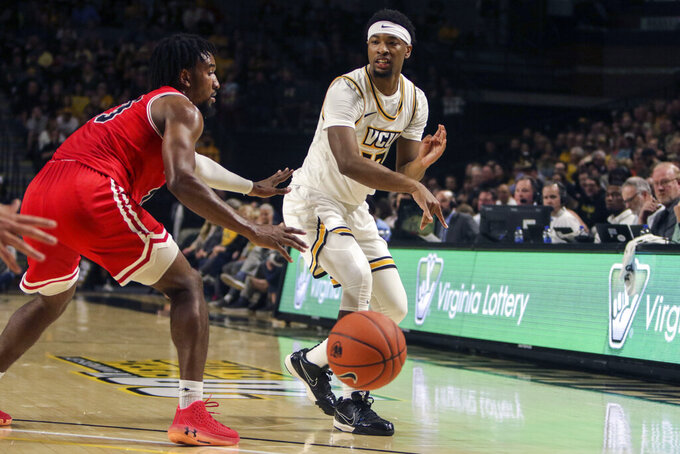 VCU guard Malik Crowfield (13) passes around St. Francis guard Keith Braxton (13) during the first half of an NCAA college basketball game in Richmond, Va., Tuesday, Nov. 5, 2019. (AP Photo/Zack Wajsgras)