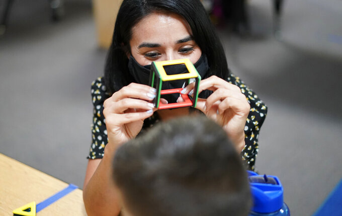 Teacher Juliana Urtubey works with a student in a class at Kermit R Booker Sr Elementary School Wednesday, May 5, 2021, in Las Vegas. Urtubey is the the 2021 National Teacher of the Year. (AP Photo/John Locher)
