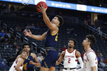 California's Matt Bradley (20) shoots against Stanford during the first half of an NCAA college basketball game in the first round of the Pac-12 men's tournament Wednesday, March 11, 2020, in Las Vegas. (AP Photo/John Locher)